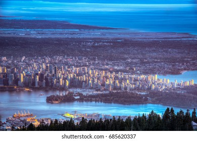 Vancouver from Grouse Mountain at sunset in summer in British Columbia