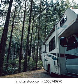Vancouver Island, Canada, 20 august, 2019 // :Old Tioga caravan parked in a camping area in typical British Columbia camping grounds