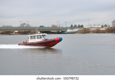 VANCOUVER - JANUARY 6, 2017: A Canada Coast Guard search and rescue vessel responds to a maritime alert on the Fraser River in Richmond, BC on January 6, 2017.