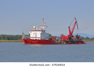 VANCOUVER - July 15,2017: A Trailing suction hopper dredger is used on the Fraser River near Vancouver, British Columbia to clear silt and debris on July 15, 2017.