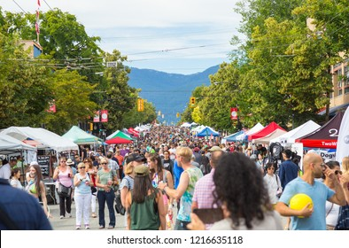 VANCOUVER JULY 8TH, 2018: Car Free Day Vancouver on Commercial Drive in Vancouver East side. People walking around with different events and street food