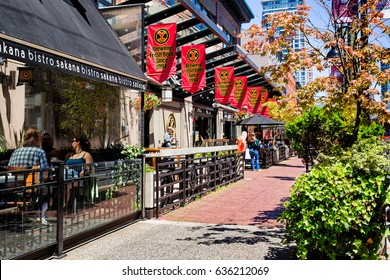 VANCOUVER- June 30, 2014: Restaurants in the trendy Yaletown neighborhood, formerly a warehouse district. Many choices, like the Japanese small plates bistro shown, and the artisan brewery next door.