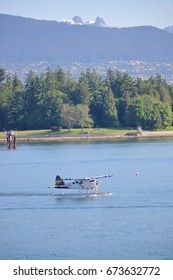 VANCOUVER - June 5, 2017: A Harbor Air Seaplane takes off in Vancouver, British Columbia with the North Shore Lion peaks in the background on June 5, 2017.
