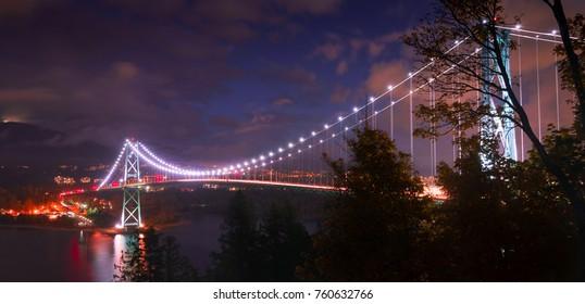 Vancouver Lions Gate Bridge cloudy night traffic commuting