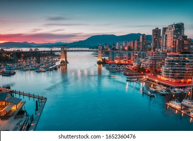 VANCOUVER - MAY 05 2019: Downtown Vancouver Canada. Scenic view at Burrard Bridge from Granville Island, Vancouver, Canada