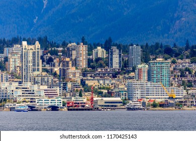 Vancouver North Shore skyline and waterfront cityscape with Grouse mountain on a cloudy day in British Columbia, Canada