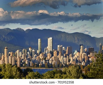 VANCOUVER skyline - the most beautiful and friendly city of Metro Vancouver is nestled on the shore of the Pacific Ocean, just under the Coast Mountains. British Columbia, Canada