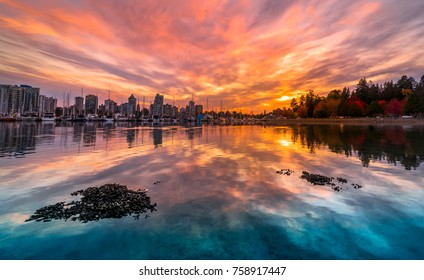 Vancouver Stanley park harbourfont sunset reflections in water