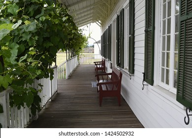 Vancouver, WA USA – June 14, 2019: The long porch in front of the Chief Factor's Residence offer a cool rest spot at reproduction Hudson Bay Co. Fort Vancouver.