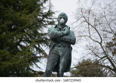 VANCOUVER,BC,CANADA-MARCH 30,2020:  Protective mask is seen on a face of a statue of Scotland's national bard Robert Burns during COVID-19 virus outbreak in Stanley Park in Vancouver.