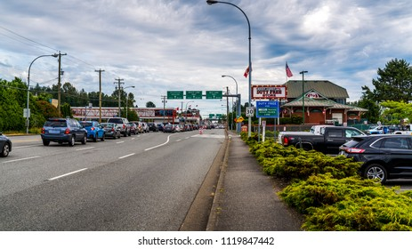 Vancouver-Blaine Hwy, Surrey, British Columbia, Canada. 06. 24. 2018. Long Line up cars at the Canada - US Peace Arch border crossing.