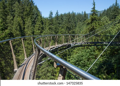 VANCOUVER,BRITISH COLUMBIA, CANADA-JULY 23: Capilano Suspension Bridge Park's cliff walk where many world tourists view the temperate rain forest on July 23, 2013 in Vancouver, Canada.