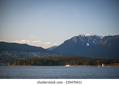 Vancouver's Stanley Park and North Shore mountains in beautiful evening light.
