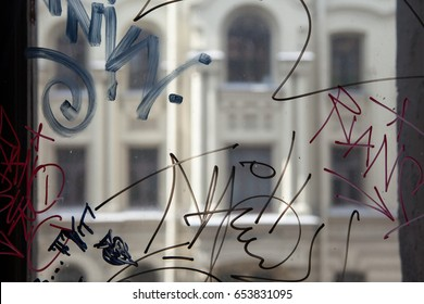 Vandal graffiti on the window of a house