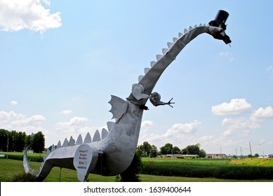 Vandalia, Illinois, USA - 2015: Kaskaskia Dragon, a 35-foot-long metal monster, and Americana tourist attraction, breathes propane flames of fire using a a self-service coin box. Near interstate I-70.