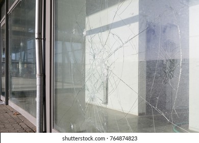 vandalized broken windows