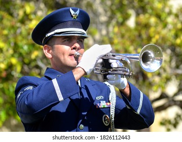 Vandenberg Air Force Base, California, USA - September 20, 2013: A U.S. Air Force Sergeant plays taps during a military ceremony honoring U.S. military Prisoners of War and Missing in Action.