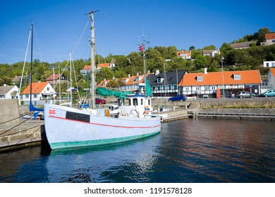 VANG, DENMARK - AUGUST 21, 2018: Ships moored in the harbor in traditional fishing hamlet on west coast of Bornholm island