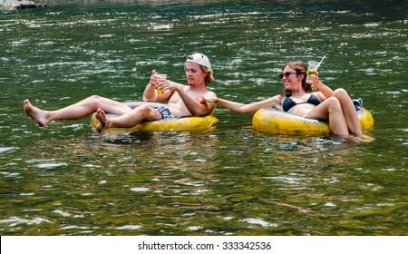 VANG VIENG, LAOS- 18 APRIL 2015 : Tourist enjoy tubing in Song River at Vang Viang, Laos.