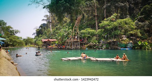 VANG VIENG, LAOS - CIRCA APRIL, 2019: Tourists admire the natural scenery in the city of Vang Vieng, Laos.