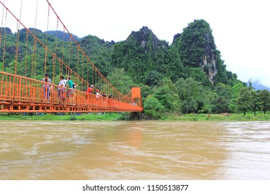 Vang vieng, Laos : July 29,2018, Unidentified tourist walking on the orange bridge and mountain in the fog background at vang vieng, Laos