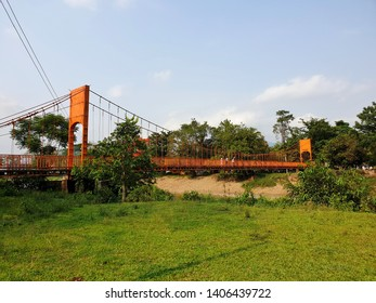 Vang Vieng, Laos. May 11, 2019. Orange bridge to  jung cave over Song River in Vang Vieng, Laos. Orange bridge is the most famous landmark of Vang Vieng, Laos.