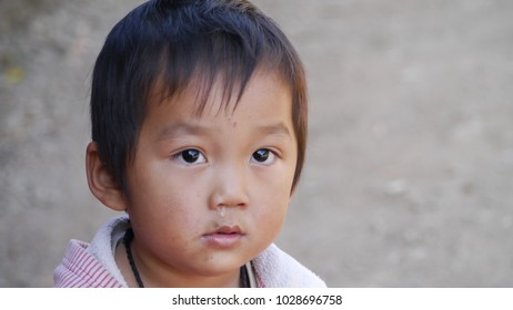 VANG VIENG, LAOS-DECEMBER 29, 2014: Portrait a little boy runny nose and has some dirty at his mouth in countryside