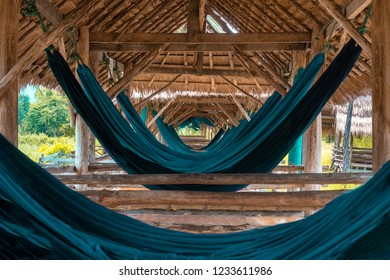 VANGVIENG LAO OCTOBER 1 2018 : a lot of hammock at smaile beach bar at Vangvieng Lao.