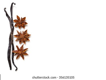 Vanilla bean and star anise on white background