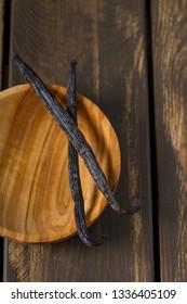 vanilla beans on wooden bowl