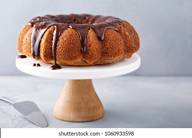Vanilla bundt cake with chocolate glaze on top