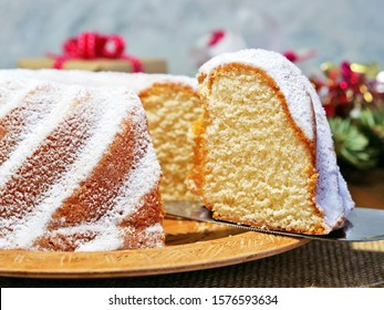 Vanilla bundt cake sliced, gugelhupf closeup on wooden platter