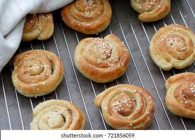 Vanilla buns on rack.