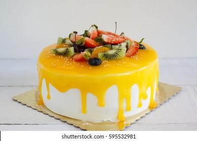 Vanilla cake with fresh cream and mixed fruit.