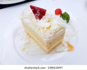 Vanilla cake on white plate.