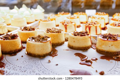 Vanilla Cheesecake pie desserts with caramel and walnut topping in the fridge.