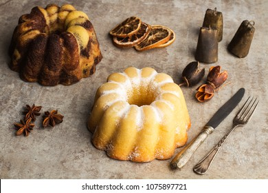 A vanilla and chocolate and a lemon bundt cake