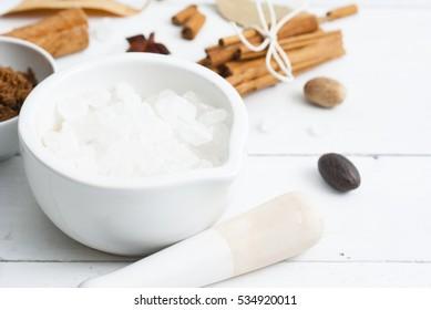 vanilla cinnamon and sugar variation on white wood table