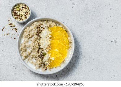 Vanilla citrus coconut overnight oatmeal. Top view, copy space.
