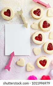 Vanilla cookies with strawberry jelly filling for Valentines Day with copy space