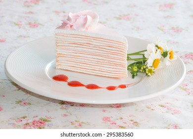 Vanilla crepe cake topping with strawberry sauce. It looks fresh  and delicious and it is my favorite dessert. You can apply for  website decor and artwork design.