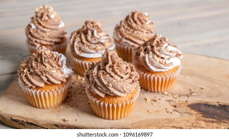 Vanilla cupcakes with chocolate cream end topping. homemade baking. Banner