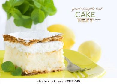 vanilla and custard cream cake dessert with fresh lemons and fresh mint and copyspace