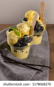 Vanilla ice cream with blackberries in the glass vases.