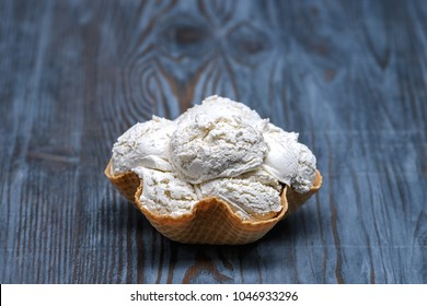 Vanilla ice cream with bowl waffer on wooden background