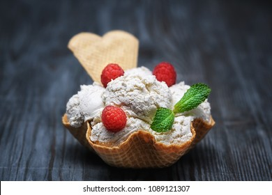 Vanilla ice cream with bowl waffer and berries on wooden background