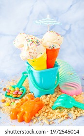 Vanilla ice cream with colorful sugar sprinkles with colorful beach toys