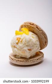 Vanilla ice cream and macaroon set on plate