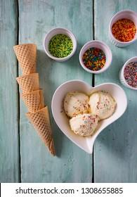 vanilla ice cream on turquoise surface