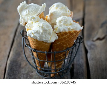 vanilla ice cream on wooden surface